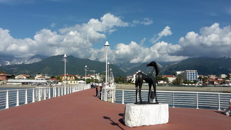 Marina di Massa: from the seaside, view of the nearby mountains (Appennini)