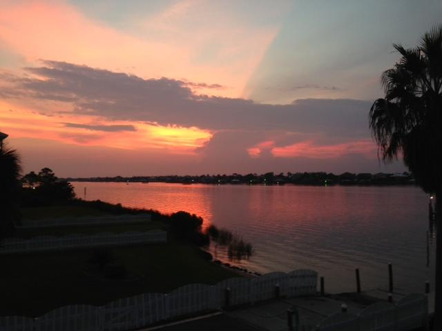 Enjoy gorgeous sunsets over scenic Old River from the breeze-filled screened back porch!
