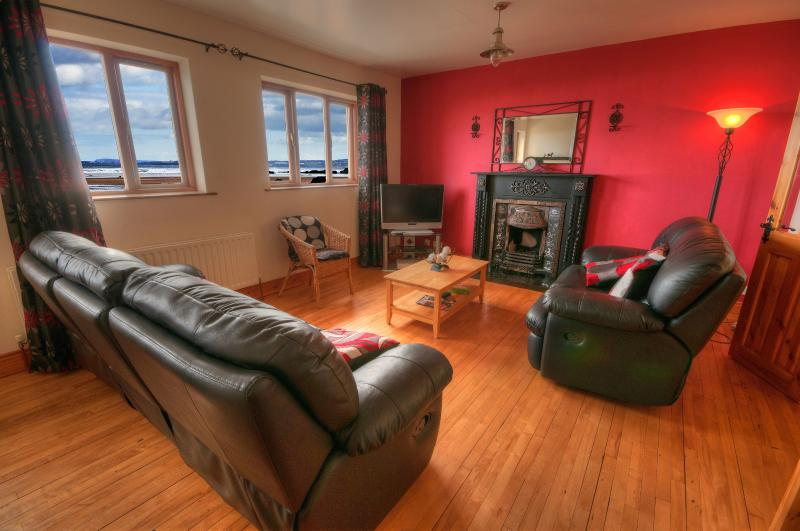 Living room upstairs with amazing views of downhill beach and Donegal