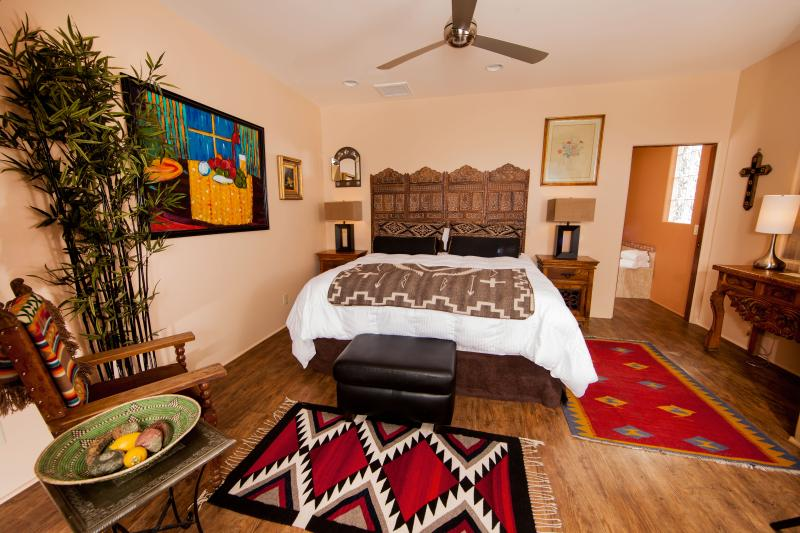 The master bedroom has a king bed, HDTV, IPod dock, large closet, and red rock views through the LR.
