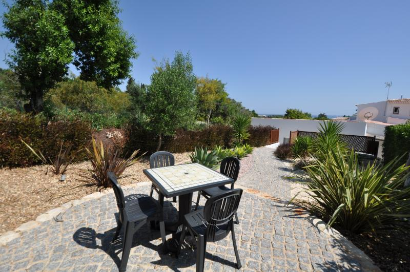 Perfect outdoor dining in this sunny private and secluded garden surrounded by olive trees.