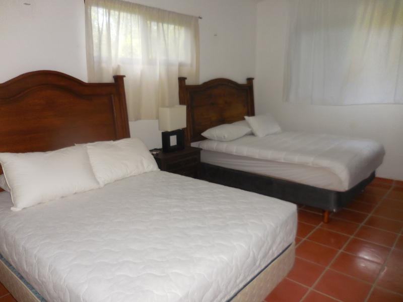 Room with two full beds upper flat
