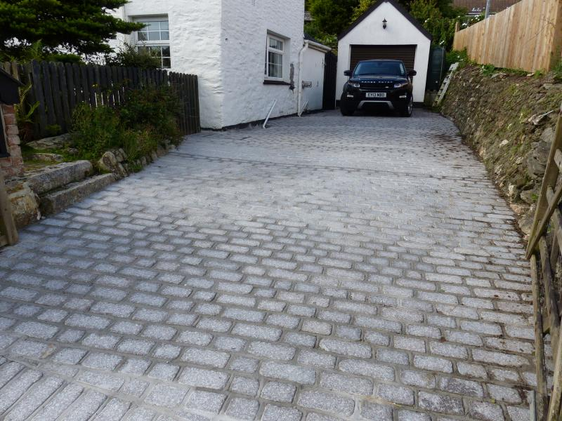 Granite driveway with room for 3 cars.  A real bonus in Crantock