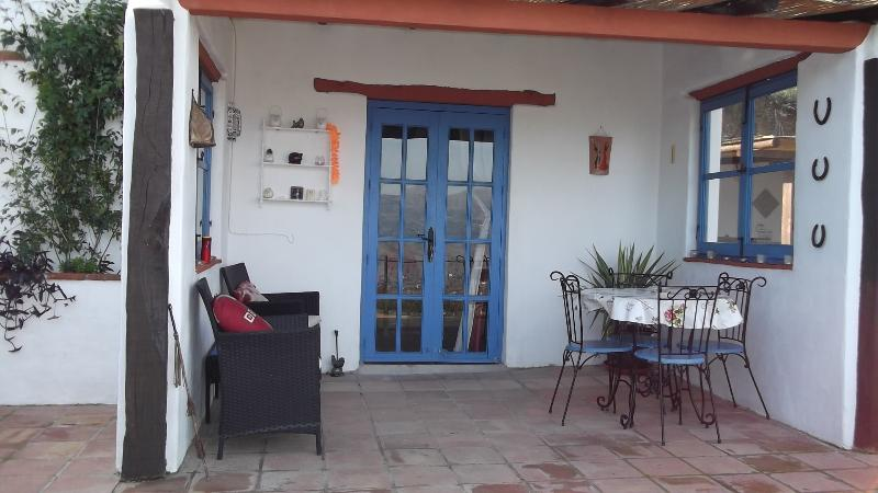 Veranda for dining, reading or just relaxing. Double French doors leads into the apartment.