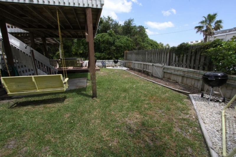 Shared Outdoor Area has 2 Grills and Grassy Yard