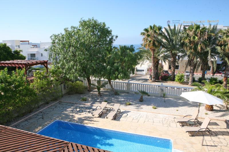 Large pool with walk in steps , set in spacious sunbathing patios