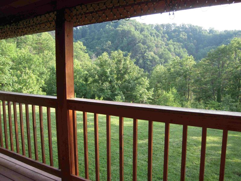 Enjoy the mountain view from the HOT TUB entry porch or the new uncover deck