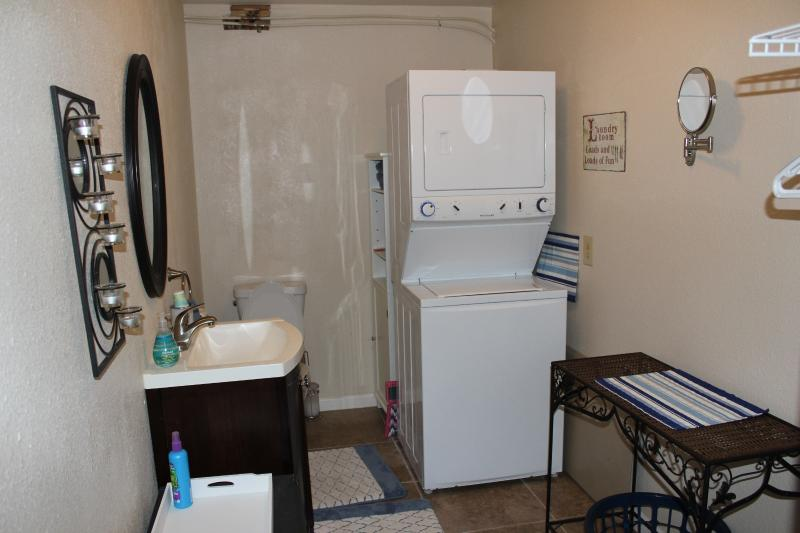 Half bath with toilet, washer and dryer
