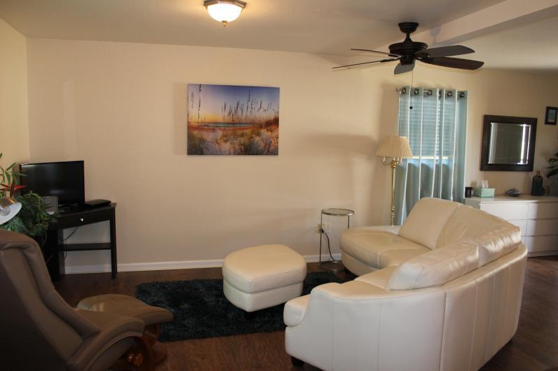 Sofa in master bedroom facing TV
