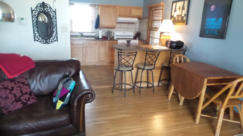 looking east into kitchen from in front of large chair