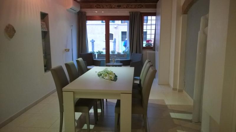 The dining room that goes to the balcony: table and chairs are italian design