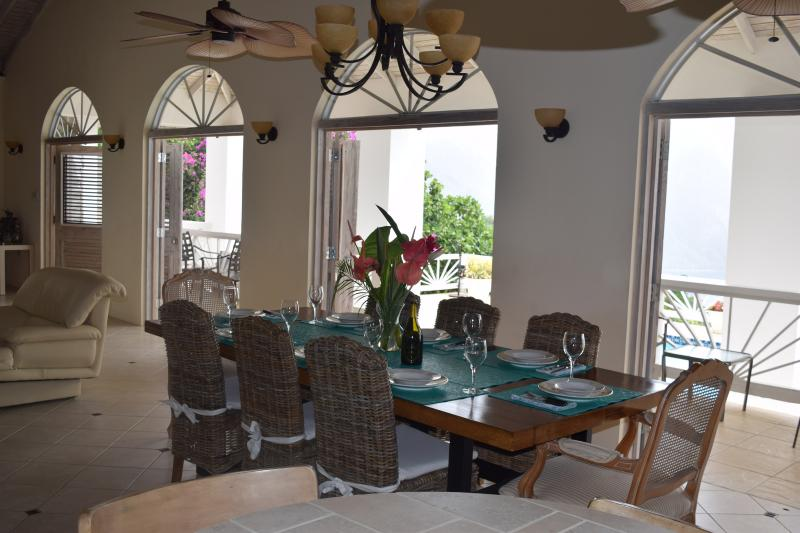 Huge solid hickory dining table seats eight in dining area with a stunning view!