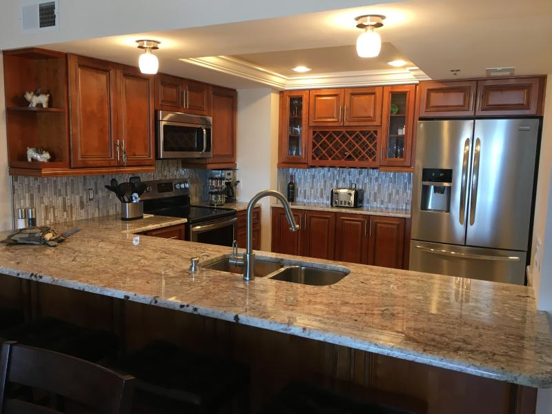 Fully Equipped kitchen with 4 bar seats and dining table for 8