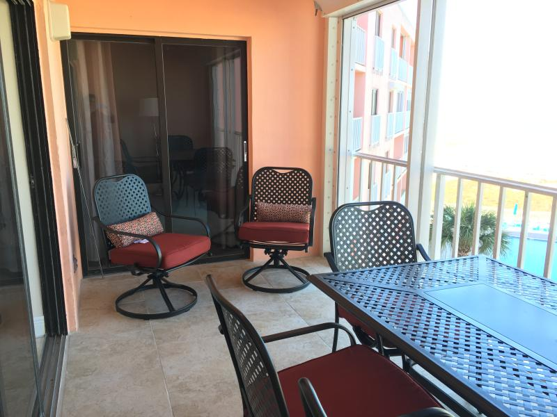 Spacious 16 foot by 8 balcony with sitting area by master bedroom
