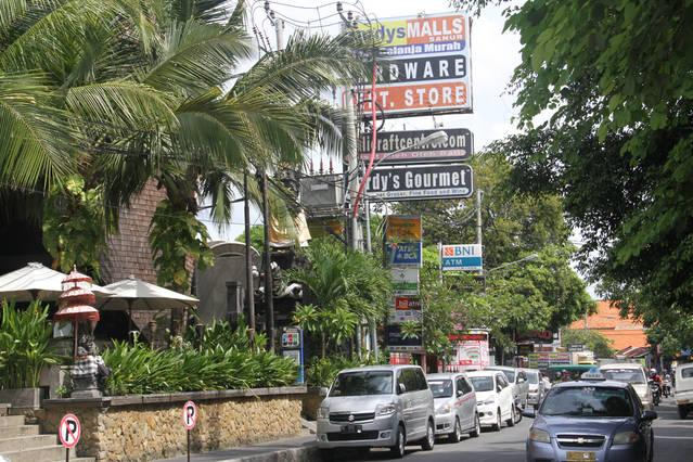 main street in Sanur with restaurants and shops and more.