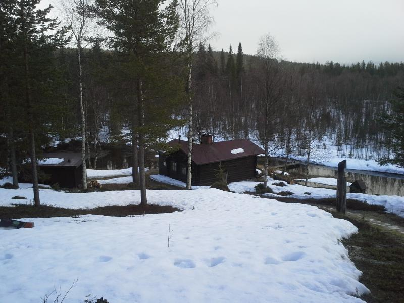 The Sauna Lodge close to a small river with running spring water