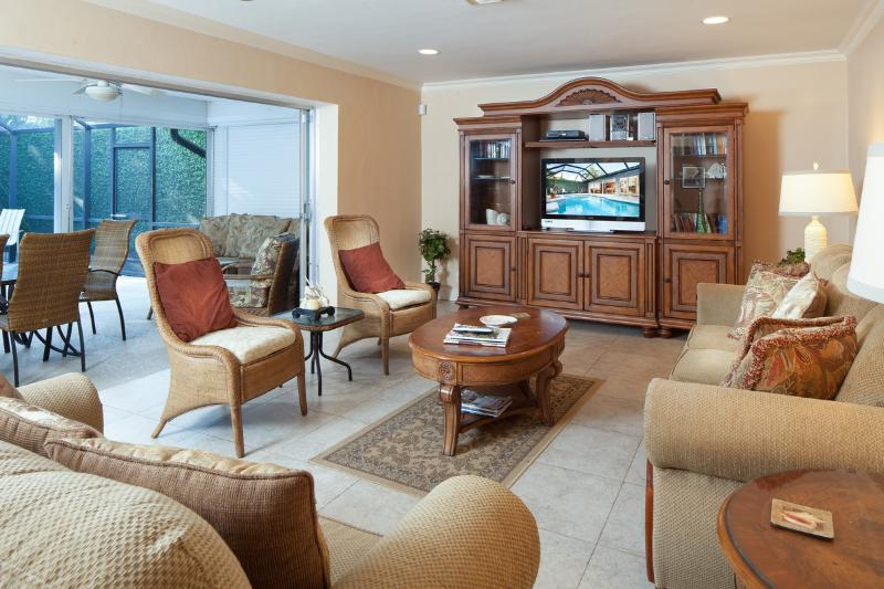 Luxury Living Area with Tommy Bahamas furniture and Sliders to Lanai and Pool
