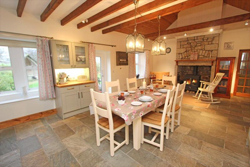 Large country style family kitchen and dining area