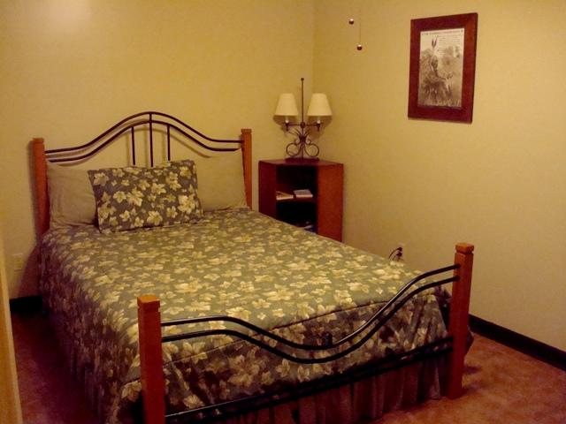 Retreat House has a queen size bed in master bedroom with privacy door.
