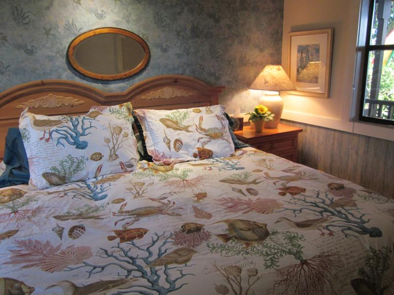 The king-size bed is famously comfortable, and the nautical decor reflects the water view.