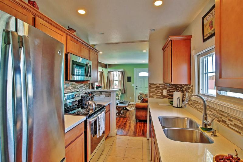 Prepare tasty home-cooked meals in this sleek fully equipped kitchen.