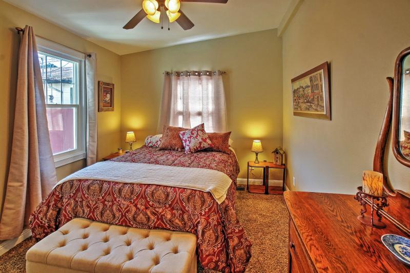 The master bedroom sleeps 2 in a cozy queen bed.