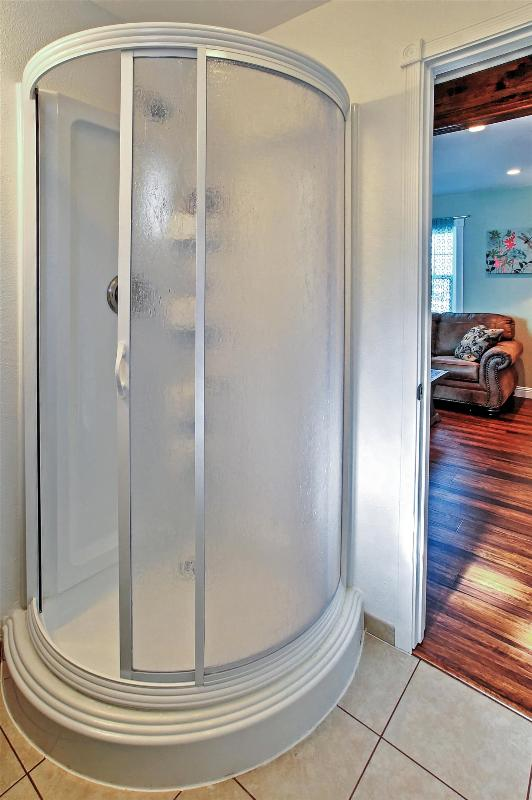 The full bathroom includes a walk in shower.