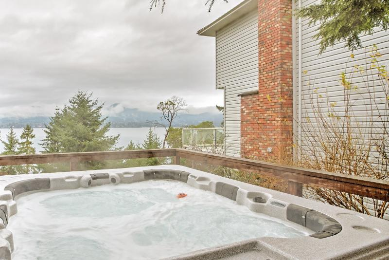 Admire stunning ocean views from this Sooke vacation rental home's private hot tub!