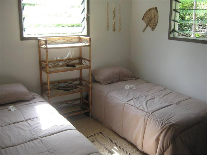 Two single beds, bush side, locally made mats on floor