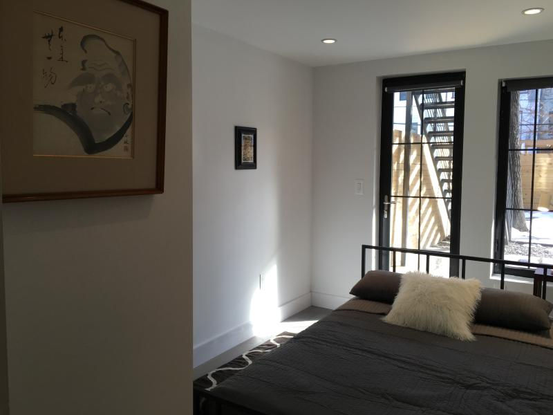 Bedroom with queen bed and direct access to the garden area