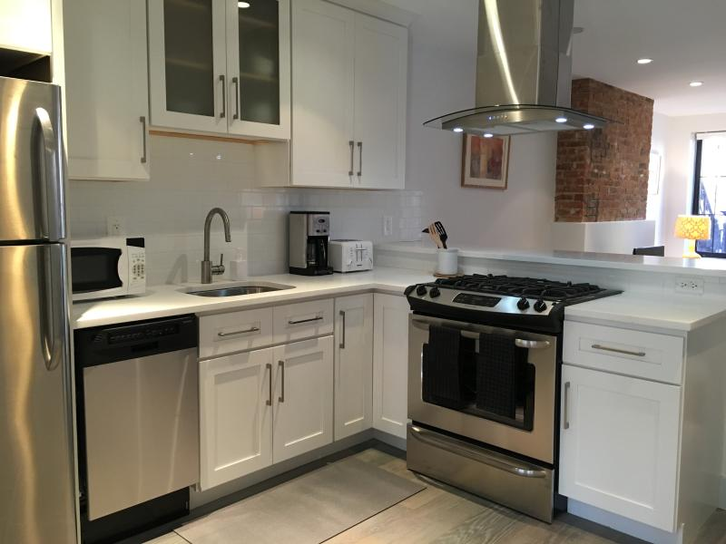 View of the renovated kitchen with brand new appliances