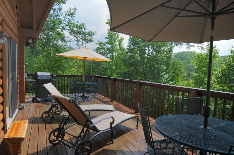 Wonderful deck space with wrought iron furniture and gas grill