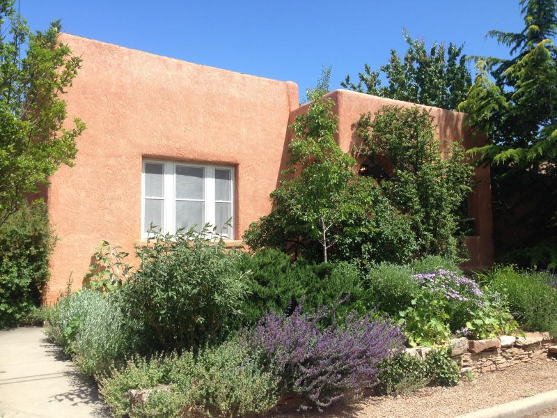 Historic adobe home on a quiet street just three blocks long. Short walk to Plaza.