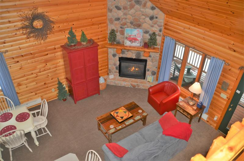 Open, vaulted great room with cozy furnishings and charming decor.