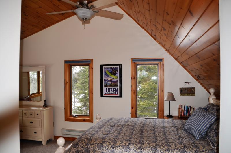 Vaulted master suite with lake and moutain views.