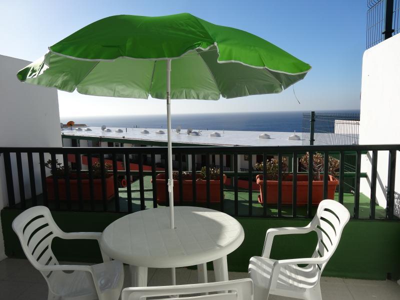 A balcony that let gets plenty of sun.