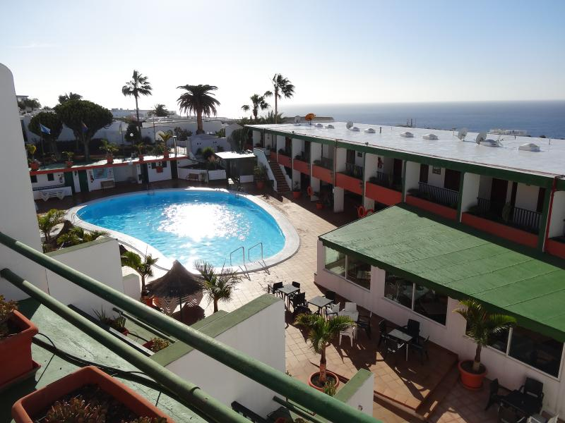 The swimming pool and bar from the balcony.
