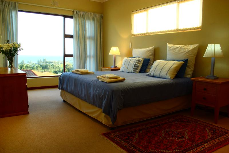Upper level bedroom with ocean view
