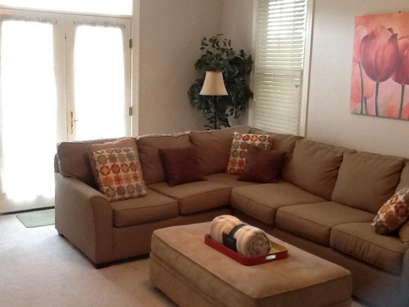 Den / family room with French doors that lead to pool deck. Queen sofa sleeper, large closet and tv