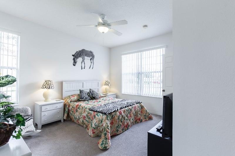The downstairs master bedroom has dual bedside cabinets and a wardrobe with pleny of hanging space.