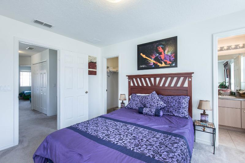 The upstairs master bedroom has a walk-in closet, dressing table and TV.