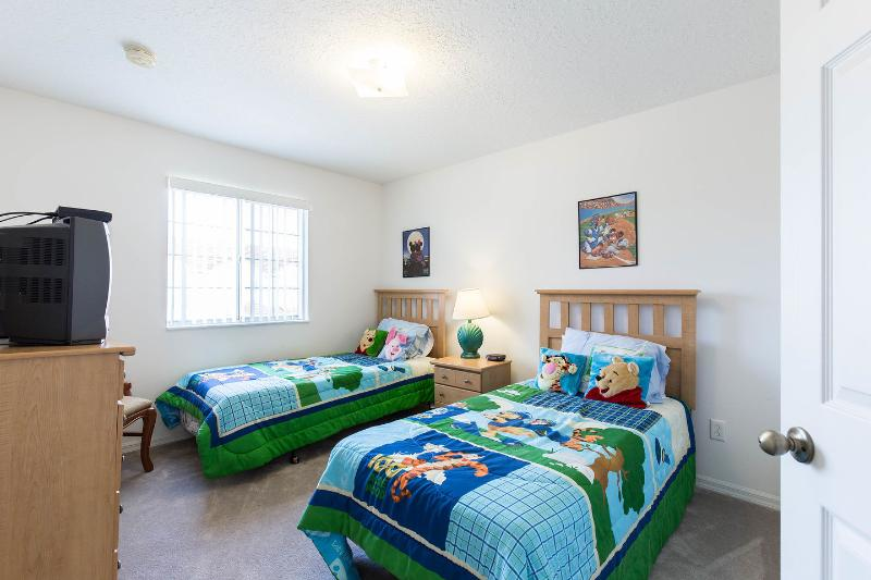 The 4th bedroom has twin beds and a Winnie the Pooh theme.