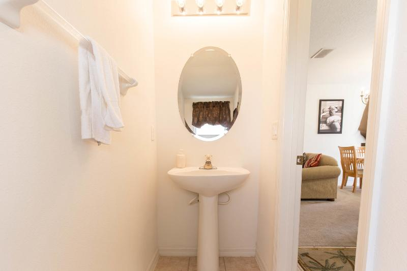 The downstairs half bathroom is conveniently situated just next to the front door as you come in.