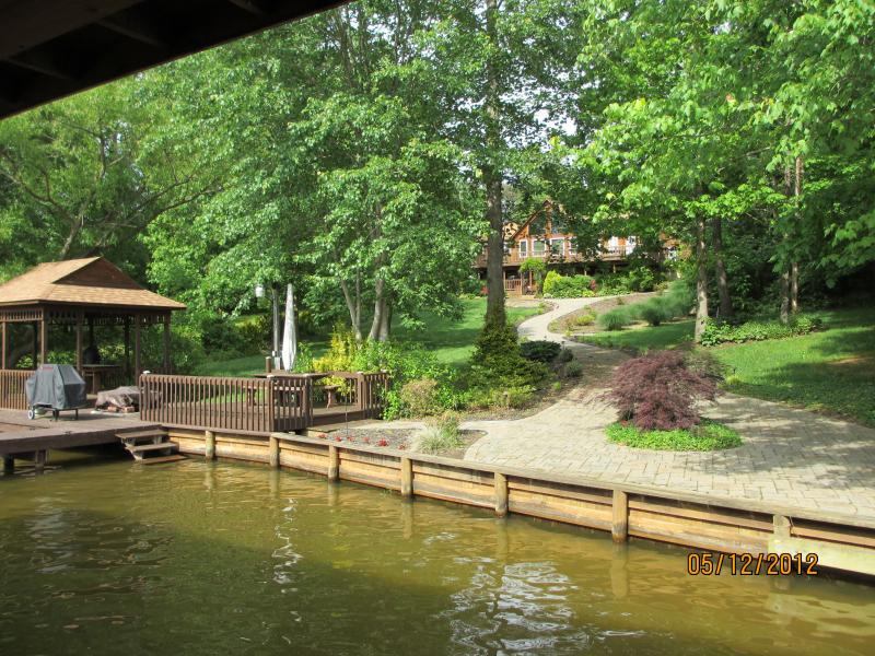 Landscaped level lot with amazing swim area both shallow and deep