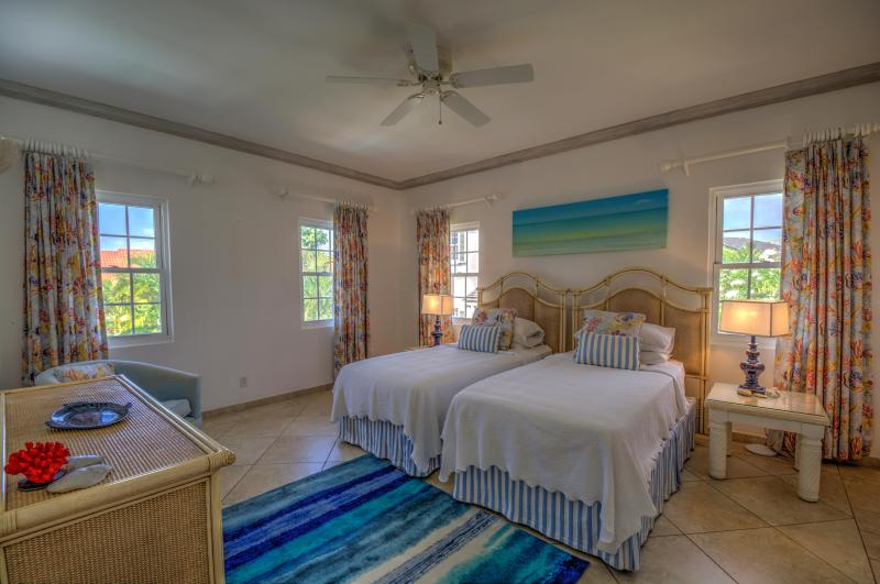 Bedroom 2, providing a calm, caribbean feel