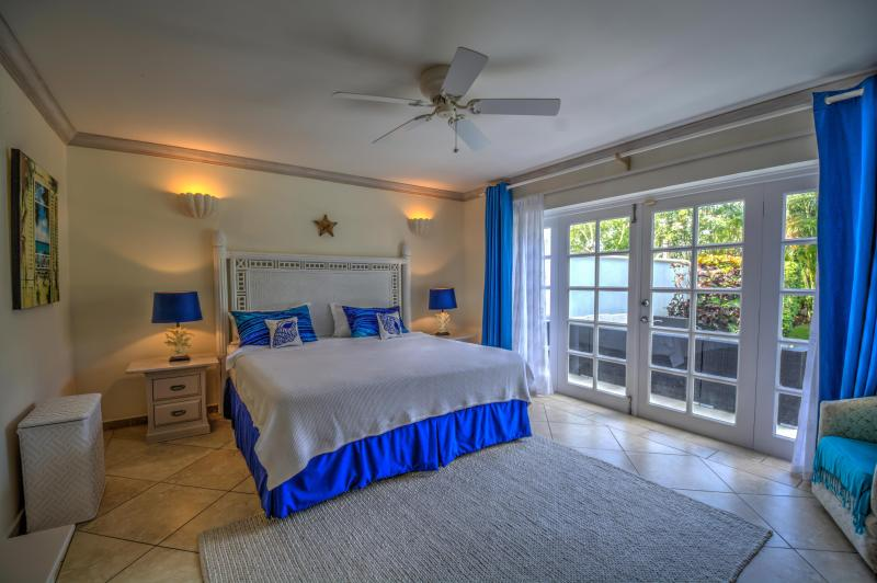 The Master bedroom with direct access to the patio and garden
