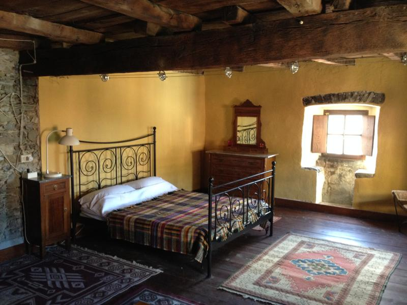The main sleeping area with original stone window seats and ancient chestnut beams.