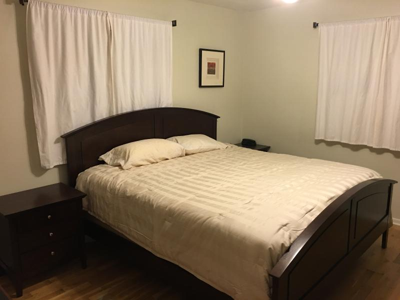 Guest bedroom with king bed. Photo doesn't show most of the artwork which is very nice