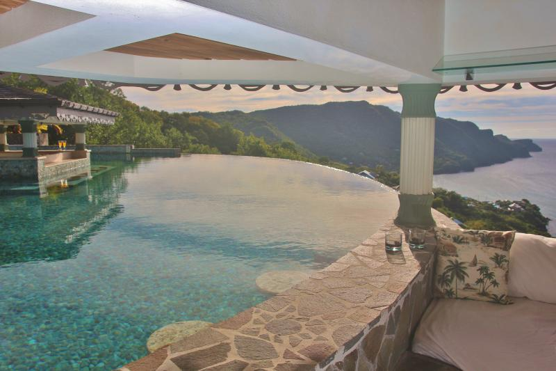 The Gazebo day bed has stunning views of the Caribbean Sea and the Infinity Pool