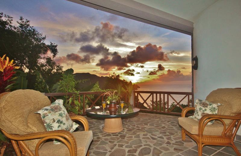 This lovely veranda has stunning views overlooking the Caribbean Sea